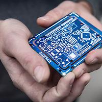 """Nederland, Haarlem, 4 maart 2016.<br /> Oprichter André Kapitein met een printplaat met chips in zijn hand die gebruikt kan worden voor een sensor.<br /> Foto: Jean-Pierre Jans<br /> <br /> """"Smartsensors.me maakt slimme sensoren, waarmee je op afstand data kan verzamelen over vrijwel<br /> alles. Van bijvoorbeeld het monitoren van de luchtkwaliteit rondom je gebouw op je iPhone, tot het<br /> automatisch detecteren van gevallen ouderen in hun woning. Doordat we alles zelf op maat maken is<br /> alles mogelijk, en omdat we alles bouwen vanaf een basisplatform zijn de kosten laag en de looptijden<br /> kort."""" Bron: smartsensors.me<br /> <br /> Smartsensors.me makes smart sensors, which lets you remotely collect data on virtually everything. For example, monitoring the air quality around you building on your iPhone and much more. Innovation award winner. <br /> Source: smartsensors.me"""