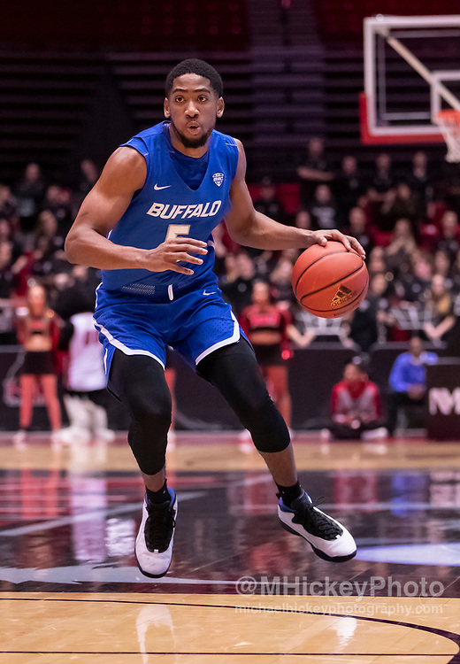 DEKALB, IL - JANUARY 22: CJ Massinburg #5 of the Buffalo Bulls dribbles the ball in the back court during the game against the Northern Illinois Huskies at NIU Convocation Center on January 22, 2019 in DeKalb, Illinois. (Photo by Michael Hickey/Getty Images) *** Local Caption *** CJ Massinburg
