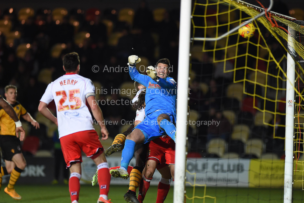 Chris Day, the Stevenage goalkeeper makes a save and watches as the ball goes just over his crossbar.  Skybet football league two match, Newport county v Stevenage at Rodney Parade in Newport, South Wales on Saturday 13th December 2014<br /> pic by Andrew Orchard, Andrew Orchard sports photography.