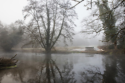 Denham, UK. 6 February, 2020. Denham Ford in early morning mist. Works planned for the HS2 high-speed rail link in the immediate vicinity include the construction of a Bailey bridge across the ford (a roadway has been laid on the far bank for this purpose) and a compound in Denham Country Park requiring the felling of mature trees. Some of the site lies within a wetland nature reserve forming part of a Site of Metropolitan Importance for Nature Conservation (SMI).