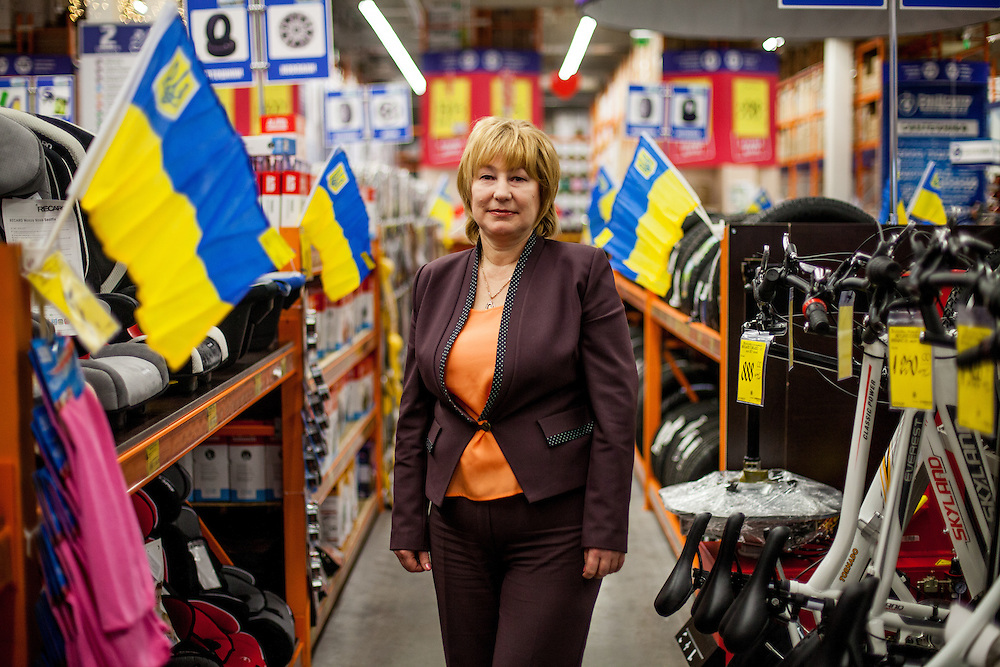 """Irina Zinko, responsible for the building supplies stores """"Epicenter"""" photographed in a store located in the city center of Lviv, Ukraine."""