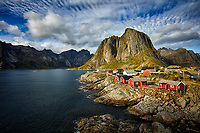 Sun sets on the village of Hamnoy in the Lofoten Islands of Norway.