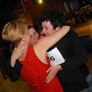 Tania Dimitrova, right, and Ulrike Hesselbarth, left, hug Claudia Neidig, center, after Neidig and her dance partner, Kristin Marunke (not shown in photo), all of Berlin, Germany, won the gold medal in the women's standard C division of the same-sex ballroom dancing competition during the 2007 Eurogames at the Waagnatie hangar in Antwerp, Belgium on July 14, 2007. ..Dimitrova is Marunke's latin dance partner. Hesselbarth is Neidig's latin dance partner. ..Over 3,000 LGBT athletes competed in 11 sports, including same-sex dance, during the 11th annual European gay sporting event. Same-sex ballroom is a growing sports that has been happening in Europe for over two decades.