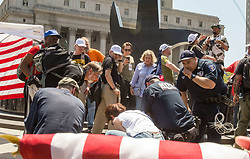 June 10, 2017 - Manhattan, New York, U.S - At a March against Sharia in Foley Square in New York City, emergency workers treat  Frank Morganthaler, the vice- president of the New York chapter of the far right militia group the Oath Keeper. He suffered what appeared to be a heart attack, after making an anti-Sharia speech.                He was later pronounced dead. (Credit Image: © Nancy Siesel via ZUMA Wire)