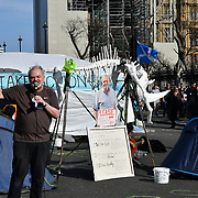 Activists continue protest on Day 5 - XRExtinction Occupy Parliament in demand the UK Govt to act of Climate Change by 2025 on 19 April 2019 at Parliament square, London, UK.