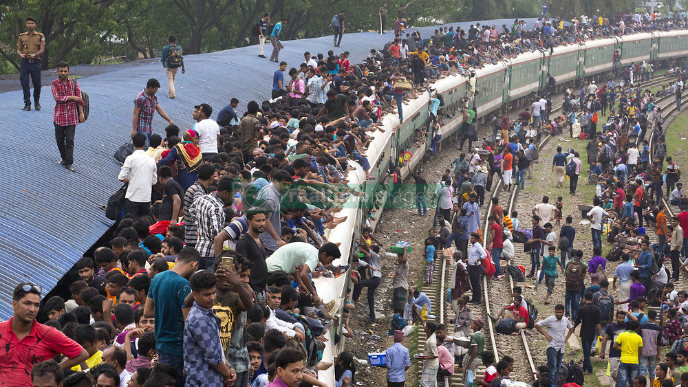 June 14, 2018 - Dhaka, Bangladesh - DHAKA, BANGLADESH - JUNE 14 : Bangladeshis cram onto a train as they travel back home to be with their families ahead of the Muslim festival of Eid al-Fitr in Dhaka , Bangladesh on June 14, 2018..Millions of city dwellers return home for Eid al-Fitr. (Credit Image: © Zakir Hossain Chowdhury via ZUMA Wire)