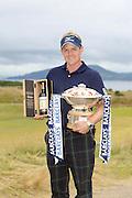Scottish Open winner 2011. Luke Donald with the winners bottle of Ballantine's 30 year old and the winner's trophy.