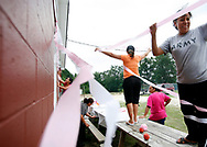 Women decorate the compound where they live with other migrant workers in preparation for a birthday party celebration for one of the women.