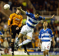 Photograph: Scott Heavey<br />Reading V Wolverhampton Wanderers. 14/05/2003.<br />Adie Williams takes a shove in the back from Kenny Miller during this Natinwide Division one playoff Semi-final, second leg match at the Madjeski Stadium.