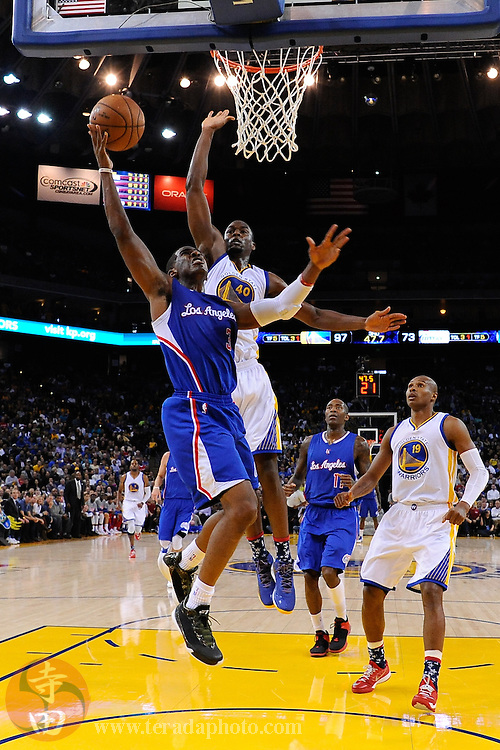 November 5, 2014; Oakland, CA, USA; Los Angeles Clippers guard Chris Paul (3) shoots a layup in front of Golden State Warriors forward Harrison Barnes (40) during the third quarter at Oracle Arena. The Warriors defeated the Clippers 121-104.