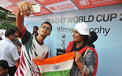"""August 30, 2017 - Kolkata, West Bengal, India - India Sports lovers hold Indian National Flag and his mobile camera Selfie at  The FIFA U17 World Cup 2017 Winners Trophy visit in Kolkata City  on August 30,2017 in India...The trophy tour will cover almost 9,000 km over a period of 40 days between August 17 and September 26.....Fans will be able to see the trophy in the six host cities starting with New Delhi, where India will be playing their group matches. The silverware will be on display in the capital city from August 17 to 22.....Guwahati will be next stop August 24-29 followed by Kolkata, which will host the final, between August 31 to September 5.  Fans in Mumbai will get to set their sight on the trophy between September 6 and 10, while it is scheduled to be on view in Goa from September 14 to 19.....The final destination will be Kochi where the trophy will reside from September 21 till 26.....Describing the event, Chairman of the LOC Praful Patel said: """"The Trophy Experience will mark the last phase of our event promotion and it is very important, because it will give the fans around the country the opportunity to get up close to the same Official Winner's Trophy that the captain of the winning team of the FIFA U-17 World Cup will be lifting on October 28 in Kolkata.....""""This is a once-in-a-lifetime chance and we hope that people can come in large numbers to the display locations in the host cities.""""....""""This initiative is about bringing the excitement of the FIFA U-17 World Cup Trophy Experience closer to India's fans in the run up to this milestone competition,"""" said FIFA Chief Commercial Officer Philippe Le Floc'h.....""""The trophy embodies both the dreams of the best U-17 players in the world and those of millions of Indian fans who will be hosting the football World Cup in October,"""" he added.....The FIFA"""