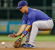 May 23, 2012; Houston, TX, USA; Chicago Cubs second baseman Darwin Barney (15) fields a ground ball against the Houston Astros during the second inning at Minute Maid Park. Mandatory Credit: Thomas Campbell-US PRESSWIRE