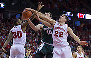 Wisconsin's Ethan Happ (22) blocks a shot by Michigan State's Matt Costello (10) in an NCAA college basketball game. (AP Photo/Andy Manis)