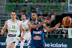 Domen Lorbek of Slovenia and Tony Parker of France during last friendly match before Eurobasket 2013 between National teams of Slovenia and France on August 31, 2013 in SRC Stozice, Ljubljana, Slovenia. (Photo by Urban Urbanc / Sportida.com)