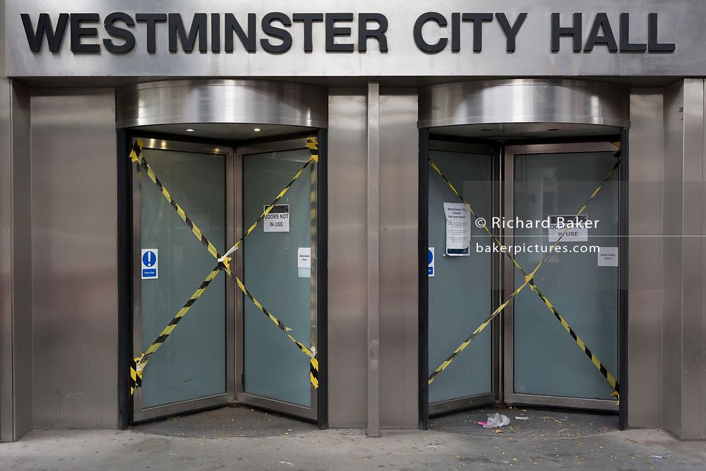 The taped up doors of Westminster City Hall on Victoria Street, on 6th September 2017, in London, England. Westminster City Council's 19-storey headquarters has closed for a £60 million refurbishment lasting nearly two years.