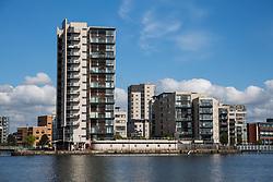 Cardiff, UK. 2nd May, 2017. Modern apartment blocks beside Roath Basin in Cardiff Docks.