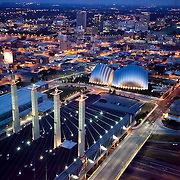 """Downtown Kansas City, Missouri and Crossroads District aerial view. Kauffman Center and Convention Center """"Skystation"""" pylons."""