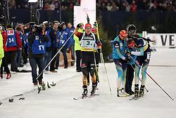 28.12.2013, Veltins Arena, Gelsenkirchen, GER, IBU Biathlon, Biathlon World Team Challenge 2013, im Bild Florian Graf (Deutschland / Germany) jubelt ueber den Sieg mit Olena Pydrushna (Ukraine), Andriy Deryzemlya (Ukraine) enttaeuscht daneben // during the IBU Biathlon World Team Challenge 2013 at the Veltins Arena in Gelsenkirchen, Germany on 2013/12/28. EXPA Pictures © 2013, PhotoCredit: EXPA/ Eibner-Pressefoto/ Schueler<br /> <br /> *****ATTENTION - OUT of GER*****