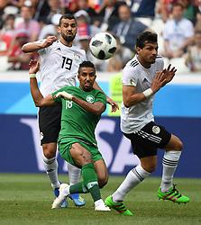 June 25, 2018 - Volgograd, Russia - SALEM ALDAWSARI (C) of Saudi Arabia vies with ABDALLA SAID (L) of Egypt during the 2018 FIFA World Cup Group A match between Saudi Arabia and Egypt in Volgograd, Russia. Saudi Arabia won 2:1.  (Credit Image: © Li Ga/Xinhua via ZUMA Wire)