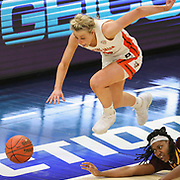 Bowling Green's Elissa Brett (5), top, and Central Michigan's Jahari Smith (21) go after a loose ball during the championship game in the Mid-American Conference (MAC) college women's basketball tournament between Bowling Green and Central Michigan at the Rocket Mortgage FieldHouse in Cleveland on Saturday, March 13, 2021. THE BLADE/KURT STEISS