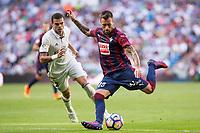 Real Madrid's Raphael Varane and Eibar's Antonio Luna  durign the match of La Liga between Real Madrid and SD Eibar at Santiago Bernabeu Stadium in Madrid. October 02, 2016. (ALTERPHOTOS/Rodrigo Jimenez)