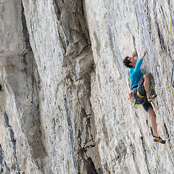 Adam Ondra warming up at the Coliseum, Echo Canyon, Canmore, Alberta
