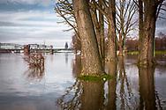 flood of the river Rhine on February 5th. 2021, the flooded meadow in the district Poll, view to the South bridge and the cathedral, Cologne, Germany.<br /> <br /> Hochwasser des Rhein am 5. Februar 2021, die ueberfluteten Rheinwiesen in Poll, Blick zur Suedbruecke und zum Dom, Koeln, Deutschland.