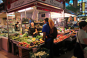 Food stall inside central market building, city of Valencia, Spain
