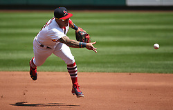 August 13, 2017 - St Louis, MO, USA - St. Louis Cardinals second baseman Kolten Wong tosses to first base to retire Atlanta Braves' Ozzie Albies in the second inning during a game between the St. Louis Cardinals and the Atlanta Braves on Sunday, August 13, 2017, at Busch Stadium in St. Louis. (Credit Image: © Chris Lee/TNS via ZUMA Wire)
