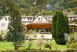 Chile, Lake Country: Flowering spring scene at Hotel Peulla in Peulla...Photo #: ch658-33227..Photo copyright Lee Foster www.fostertravel.com, lee@fostertravel.com, 510-549-2202.
