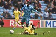 Coventry City striker Amadou Bakayoko (21) is tackled by Bristol Rovers defender Tom Lockyer (4) during the EFL Sky Bet League 1 match between Coventry City and Bristol Rovers at the Ricoh Arena, Coventry, England on 7 April 2019.