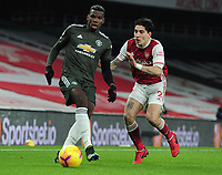 Football - 2020 / 2021 Premier League - Arsenal vs Manchester United - Emirates Stadium<br /> <br /> Paul Pogba of United and Hector Bellerin of Arsenal <br /> <br /> COLORSPORT/ANDREW COWIE