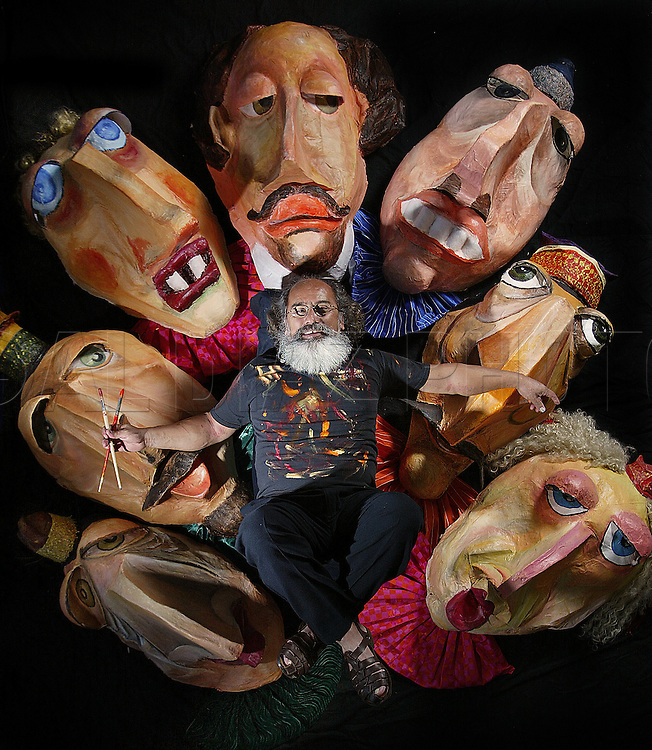 Alberto Meza, Florida Professor of the Year, poses with Shakespearean Renaissance Masks made by his art students at Miami-Dade College-Kendall Campus.