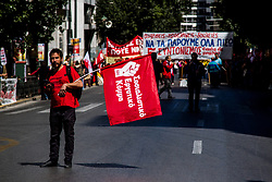 May 1, 2019 - Athens, Greece - A man holds a flag. Unions march due to labor day celebration, in Athens (Credit Image: © Kostas Pikoulas/Pacific Press via ZUMA Wire)