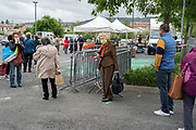 outdoors farmers market food shoppers standing inline during Covid 19 crisis France Limoux April 2020