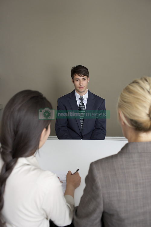 Jul. 26, 2008 - 2 businesswomen interviewing man. Model and Property Released (MR&PR) (Credit Image: © Cultura/ZUMAPRESS.com)