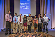 Purchase, NY – 31 October 2014. The winning team from White Plains High School on stage. (Left to right: Frank Marte, Matthew Garrison, Robert Lovitch, Victoria Torres, Alisa  Chaibay, Jesseca  Simpson,  Samarsha Drysdale,  Ross Van Doron.) The Business Skills Olympics was founded by the African American Men of Westchester, is sponsored and facilitated by Morgan Stanley, and is open to high school teams in Westchester County.