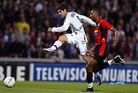 Fotball<br /> Lyon v Rennes<br /> 24. april 2004<br /> Foto: Digitalsport<br /> NORWAY ONLY<br /> <br />  JUNINHO (LYON) / ABDELSLAM OUADDOU (REN)