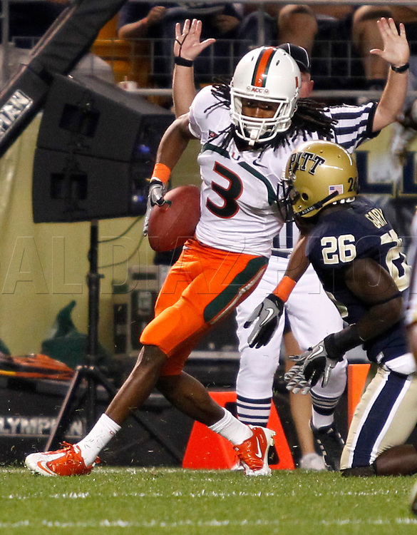 Miami Hurricanes wide receiver Travis Benjamin (3) scores in the fourth quarter as Pittsburgh Panthers cornerback Ricky Gary (26) fails to defend during The University of Miami  vs The University of Pittsburgh Panthers at Heinz Field in Pittsburgh, PA, on Thursday, September 23, 2010.