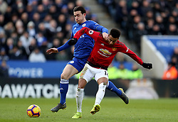 Leicester City's Harry Maguire battles for the ball with Manchester United's Jesse Lingard