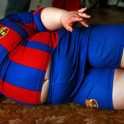 Dzhambulat Khotokhov, 6, one of the fattest boys in the world, at home in Terek, in southern Russia. Now 1.4 metres tall and weighing about 100 kg, Khotokhov has grabbed world attention as the biggest kid in the world since he was three. .Khotokhov lives with his mother Neyla and his brother, 14-year-old Mukha. .