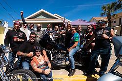Hawaiian Bob Hattori with friends at his week-long house party near Main Street during Daytona Bike Week. Daytona Beach, FL. USA. Friday March 16, 2018. Photography ©2018 Michael Lichter.