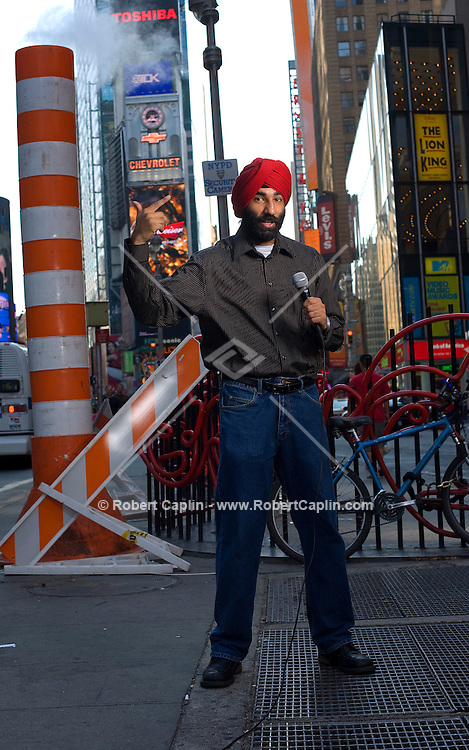 Comedian Narinder Singh poses for a portrait New York's Times Square, Aug. 21, 2008.