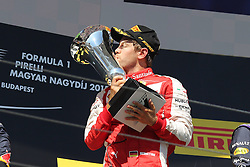 26.07.2015, Hungaroring, Budapest, HUN, FIA, Formel 1, Grand Prix von Ungarn, Rennen, im Bild Sebastian Vettel (Scuderia Ferrari) kuesst den Pokal // during the race of the Hungarian Formula One Grand Prix at the Hungaroring in Budapest, Hungary on 2015/07/26. EXPA Pictures © 2015, PhotoCredit: EXPA/ Eibner-Pressefoto/ Bermel<br /> <br /> *****ATTENTION - OUT of GER*****