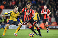 AFC Bournemouth Midfielder, Joshua King (17) gets away from Arsenal Midfielder, Aaron Ramsey (8) during the Premier League match between Bournemouth and Arsenal at the Vitality Stadium, Bournemouth, England on 3 January 2017. Photo by Adam Rivers.