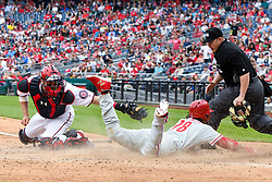 May 6, 2018 - Washington, DC, U.S. - WASHINGTON, DC - MAY 06:  Philadelphia Phillies center fielder Pedro Florimon (18) slides safely home to score on a late throw to Washington Nationals catcher Matt Wieters (32) during the game between the Philadelphia Phillies  and the Washington Nationals on May 6, 2018, at Nationals Park, in Washington D.C.  The Washington Nationals defeated the Philadelphia Phillies, 5-4.  (Photo by Mark Goldman/Icon Sportswire) (Credit Image: © Mark Goldman/Icon SMI via ZUMA Press)