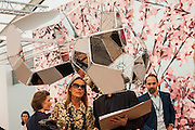 Metal and mirror panels by Tomas Saranceno in front of Hanami by Thomas Demand, Esher Schipper Gallery - ,Frieze London and Frieze Masters 2014, Regents Park, London, 14 Oct 2014.