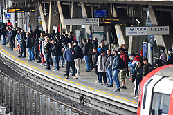 © Licensed to London News Pictures. 18/05/2020.  London UK:  Commuters at Canning Town station in Newham, east London, crowd the transport hub after the mayor Sadiq Khan reinstated the congestion charge for London. Recent advice from Government was not to travel on public transport unless social distancing measures can be observed , Photo credit: Steve Poston/LNP