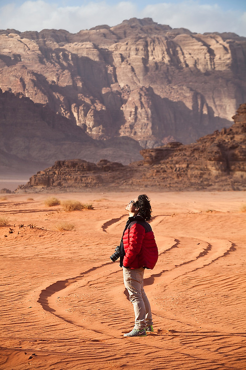 SeongRyeong Bak walks down a Jeep track through the red sand desert of Wadi Rum, Jordan
