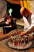 Grilled Ayu Fish, served robotayaki style. Fresh fish is an important form of food for the Japanese, who consume it nearly every day